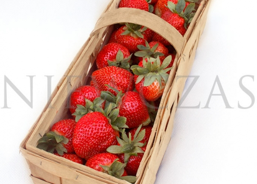 Grandarosa strawberry fruits in a wooden box