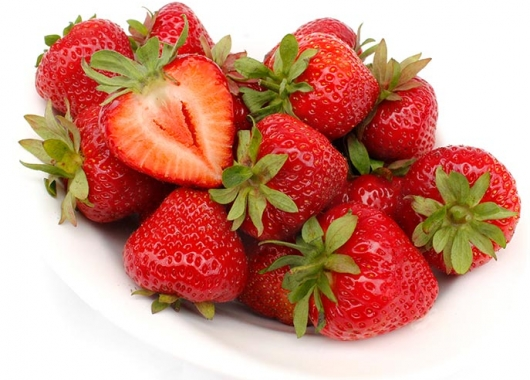 Cut strawberry fruit of Markat on a plate