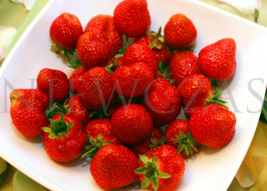 Honeoye red strawberries on a plate
